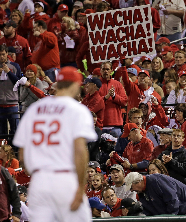 . Fans cheer as St. Louis Cardinals starting pitcher Michael Wacha walks back to the dugout during the fourth inning of Game 6 of the National League baseball championship series against the Los Angeles Dodgers Friday, Oct. 18, 2013, in St. Louis. (AP Photo/David J. Phillip)