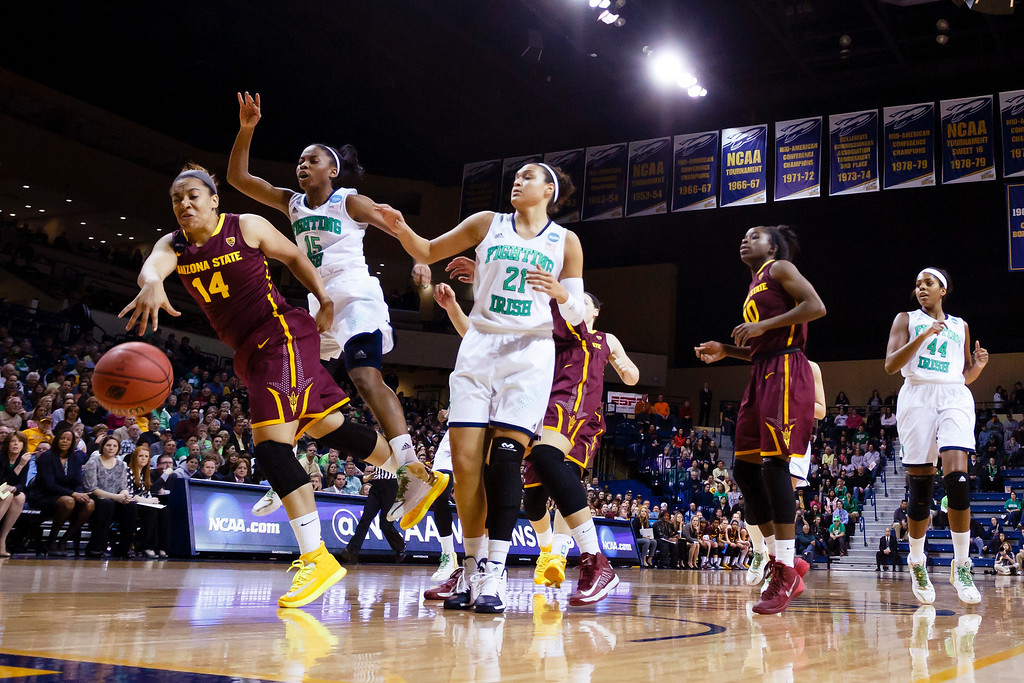 . Arizona State guard Adrianne Thomas (14) goes after a loose ball in front of Notre Dame guard Lindsay Allen (15) and guard Kayla McBride (21) during the first half in a second-round game in the NCAA women\'s college basketball tournament  in Toledo, Ohio, Monday, March 24, 2014. (AP Photo/Rick Osentoski)