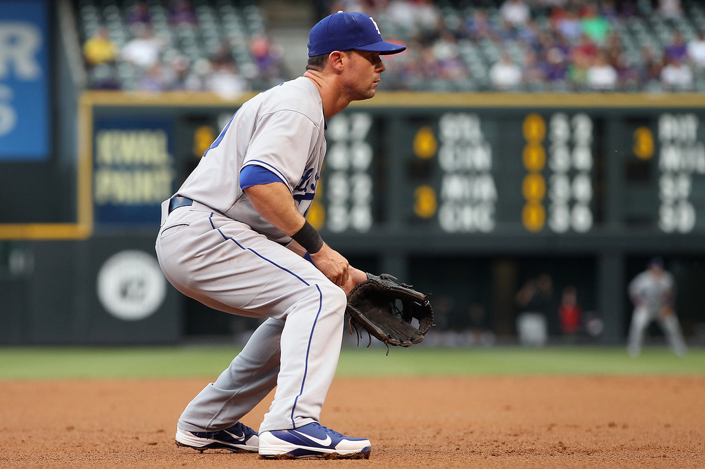 . Third baseman Michael Young #10 of the Los Angeles Dodgers makes his first start as a Dodger as they face the Colorado Rockies at Coors Field on September 3, 2013 in Denver, Colorado.  (Photo by Doug Pensinger/Getty Images)