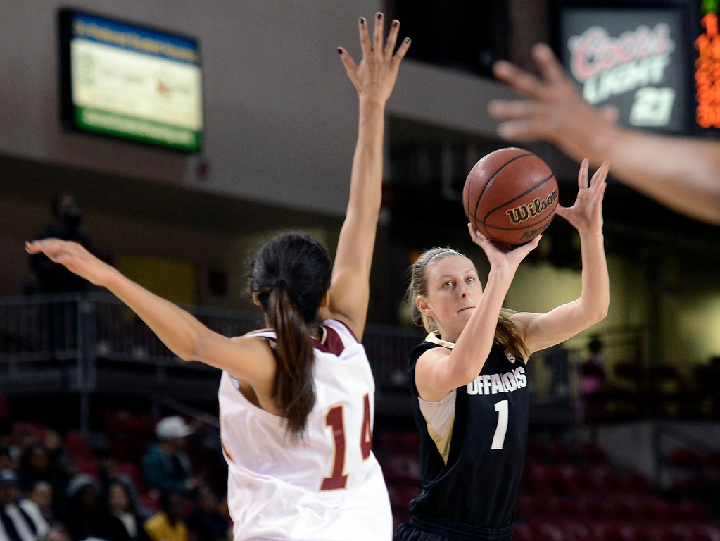 . University of Colorado\'s Lexy Kresl shoots a three-pointer over Kailey Edwards during a games against the University of Denver on Tuesday, Dec. 11, at the Magnus Arena on the DU campus in Denver.   (Jeremy Papasso/Daily Camera)