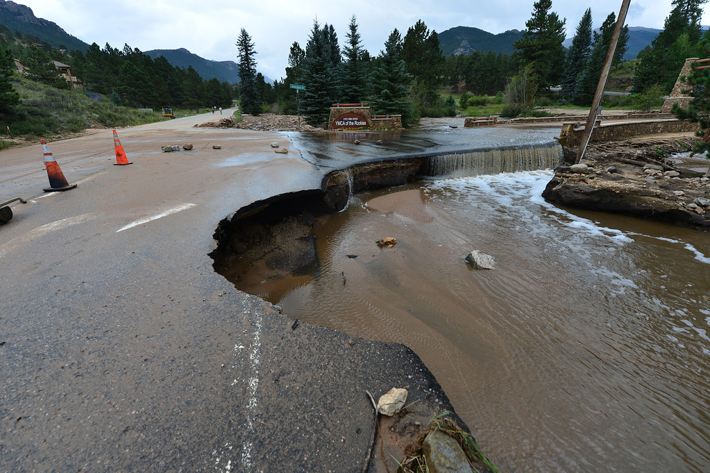. A sink hole compromises the road into the YMCA of the Rockies after the historic rain and flash flooding this week. The rains undercut several sections of Spur 66 and breached the dam that held back Dorsey Lake. Walt Hester/Estes Park Trail-Gazette