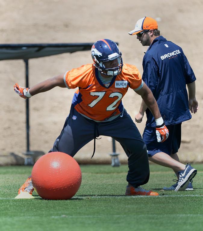 . Denver Broncos Hall Davis (72) runs through drills during OTAs June 12, 2014 at Dove Valley. (Photo by John Leyba/The Denver Post)