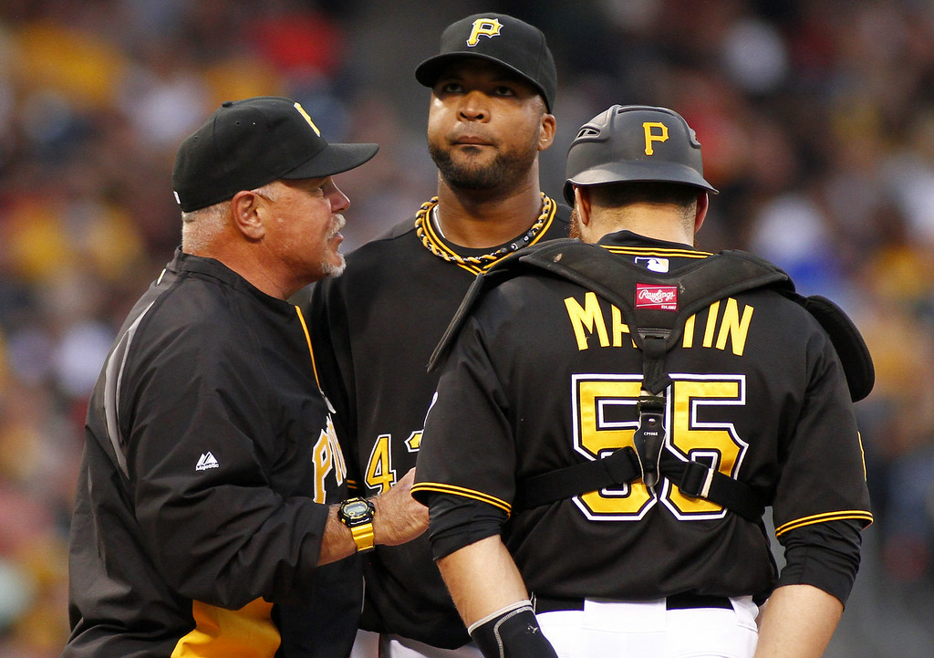 . PITTSBURGH, PA - JULY 18:  Pitching coach Ray Searage #54 of the Pittsburgh Pirates talks with Francisco Liriano #47 and Russell Martin #55 of the Pittsburgh Pirates in the first inning against the Colorado Rockies during the game at PNC Park on July 18, 2014 in Pittsburgh, Pennsylvania.  (Photo by Justin K. Aller/Getty Images)