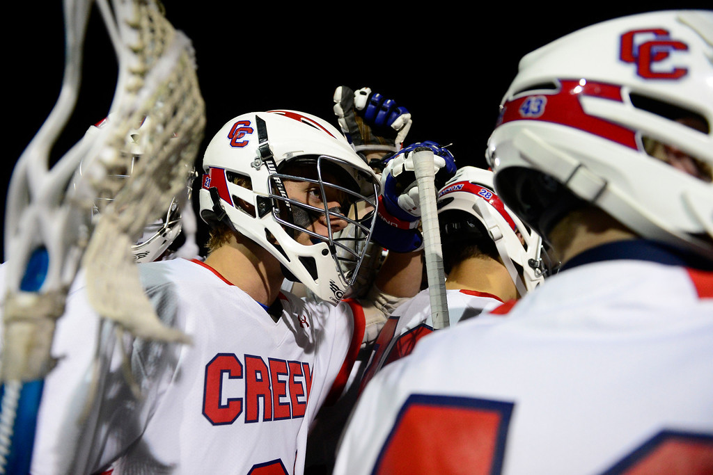 . Cherry Creek\'s Hunter Burton huddles with teammates during Cherry Creek\'s 7-6 win.  (Photo by AAron Ontiveroz/The Denver Post)