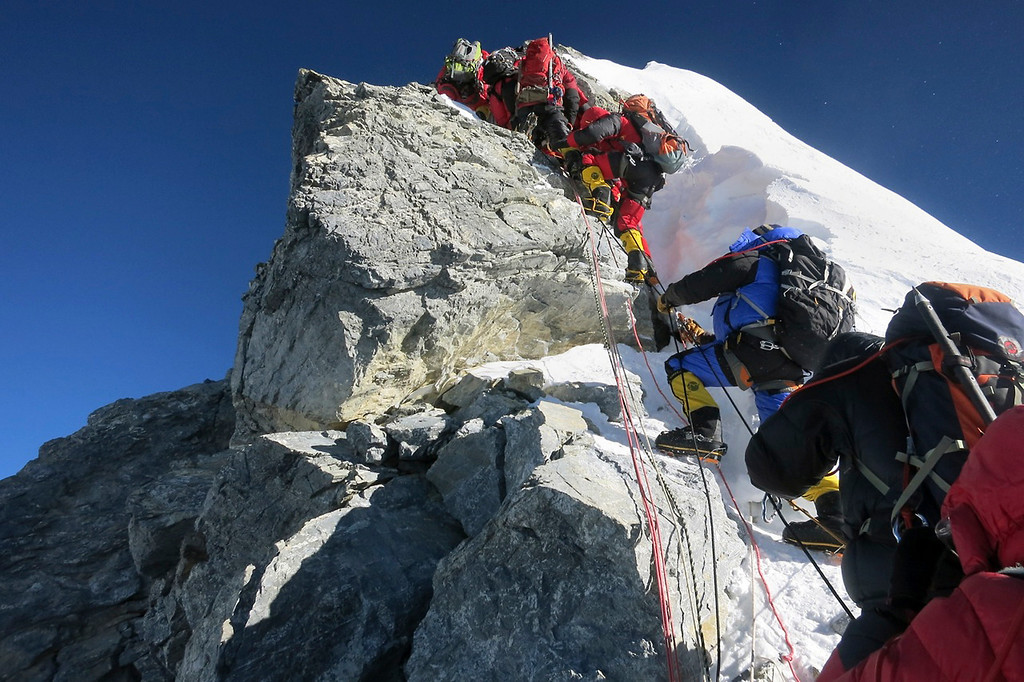 . Climbers navigate the Hillary Step just below the summit of Mount Everest, in the Khumbu region of the Nepal Himalayas on May 18, 2013.  (AP Photo/Alpenglow Expeditions, Adrian Ballinger)