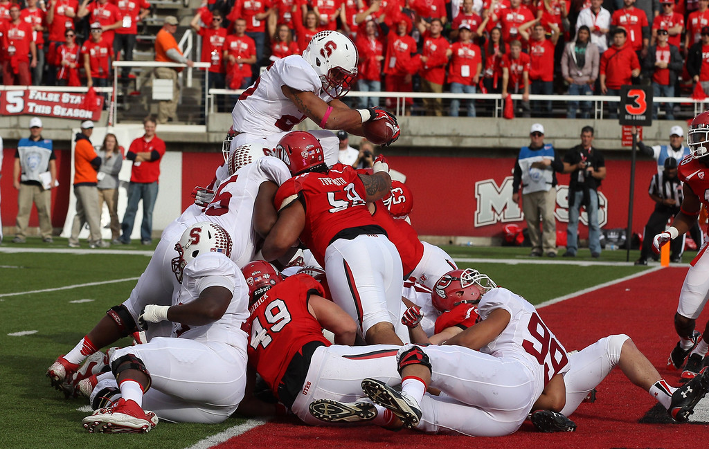 . Stanford running back Tyler Gaffney (25) scores a touchdown during the first quarter of an NCAA college football game against Utah on Saturday, Oct. 12, 2013, in Salt Lake City. (AP Photo/Rick Bowmer)