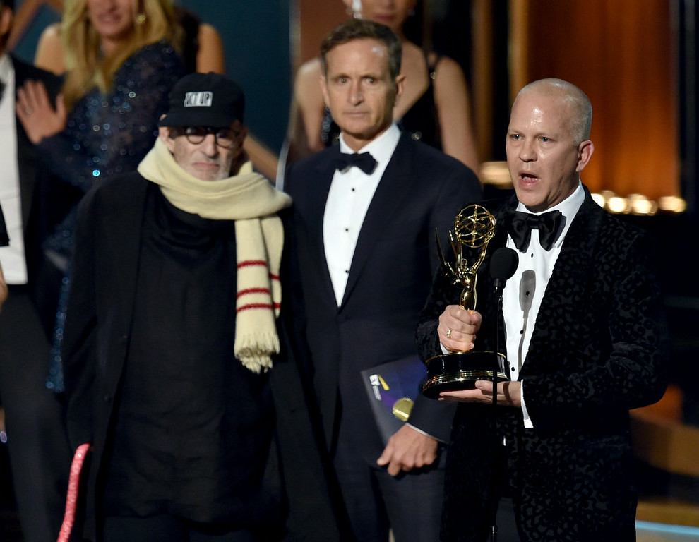 . Writer Larry Kramer (L) and director/producer Ryan Murphy (R) accept Outstanding Television Movie for \'The Normal Heart\' onstage at the 66th Annual Primetime Emmy Awards held at Nokia Theatre L.A. Live on August 25, 2014 in Los Angeles, California.  (Photo by Kevin Winter/Getty Images)