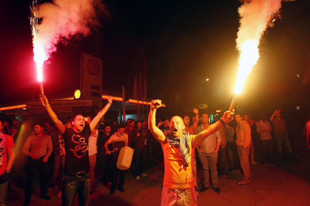 . Anti-government protesters light flares during a demonstration in central Ankara June 11, 2013.     AFP PHOTO / ADEM  ALTAN/AFP/Getty Images
