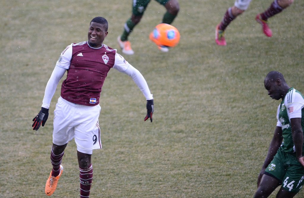 . COMMERCE CITY MARCH 22: Edson Buddle of Colorado Rapids (9), left, is in action in the 2nd half of the game against Portland Timbers at Dick\'s Sporting Goods Park. Commerce City, Colorado. March 22. 2014. Colorado won 2-0. (Photo by Hyoung Chang/The Denver Post)