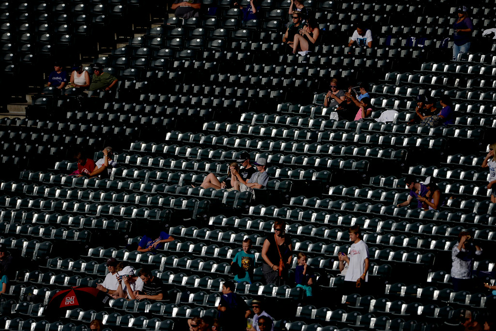 . Fans soak up the sun\'s rays before the action started at Coors Field. Major League Baseball action between the Colorado Rockies and the Washington Nationals on Monday, July 21, 2014. (Photo by AAron Ontiveroz/The Denver Post)
