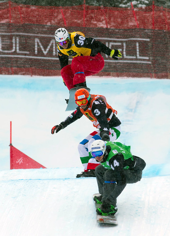 . In this image provided by Nathan Bilow Photography, Tommaso Leoni, center, from Italy, competes in the snowboard cross team World Cup event in Telluride, Colo., Saturday, Dec. 15, 2012. Leoni and teammate Emanuel Perathoner placed second in Saturday\'s race. (AP Photo/Nathan Bilow)