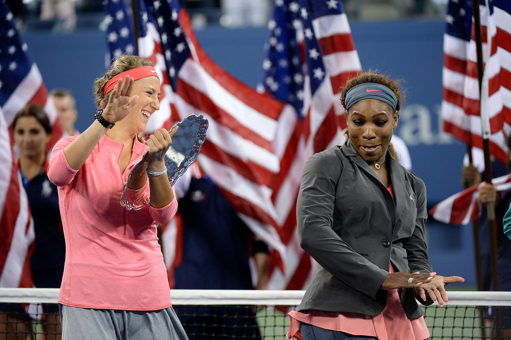 . Victoria Azarenka of Belarus(L) holds the runner-up trophy after being defeated by Serena Williams of the US (R) during their 2013 US Open women\'s singles final match at the USTA Billie Jean King National Tennis Center September 8, 2013 in New York.   STAN HONDA/AFP/Getty Images