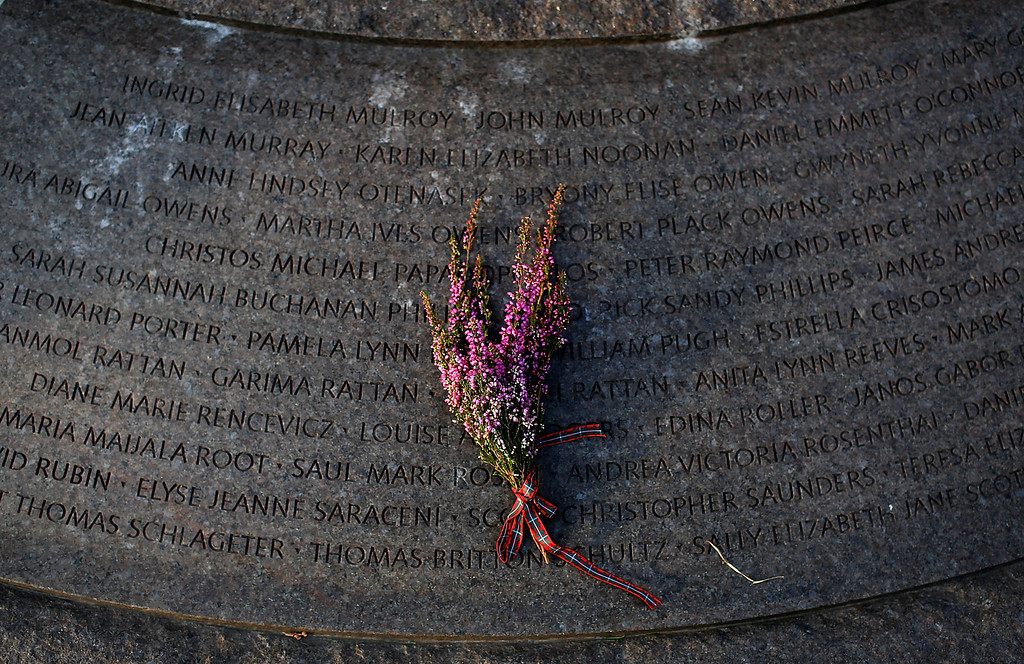 . A bouquet of Scottish heather left at the base of a cairn during a remembrance ceremony at Arlington National Cemetery December 21, 2013 in Arlington, Virginia.  (Photo by Win McNamee/Getty Images)