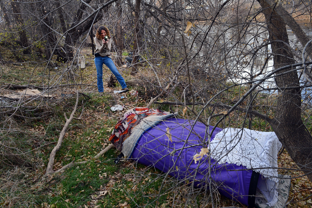. Kelly Uhing, of the Denver Department of Parks and Recreation, photographs shelters left for a colony of feral cats along South Platte River Dr. in Denver, CO, Thursday December 06, 2012.  Craig F. Walker, The Denver Post