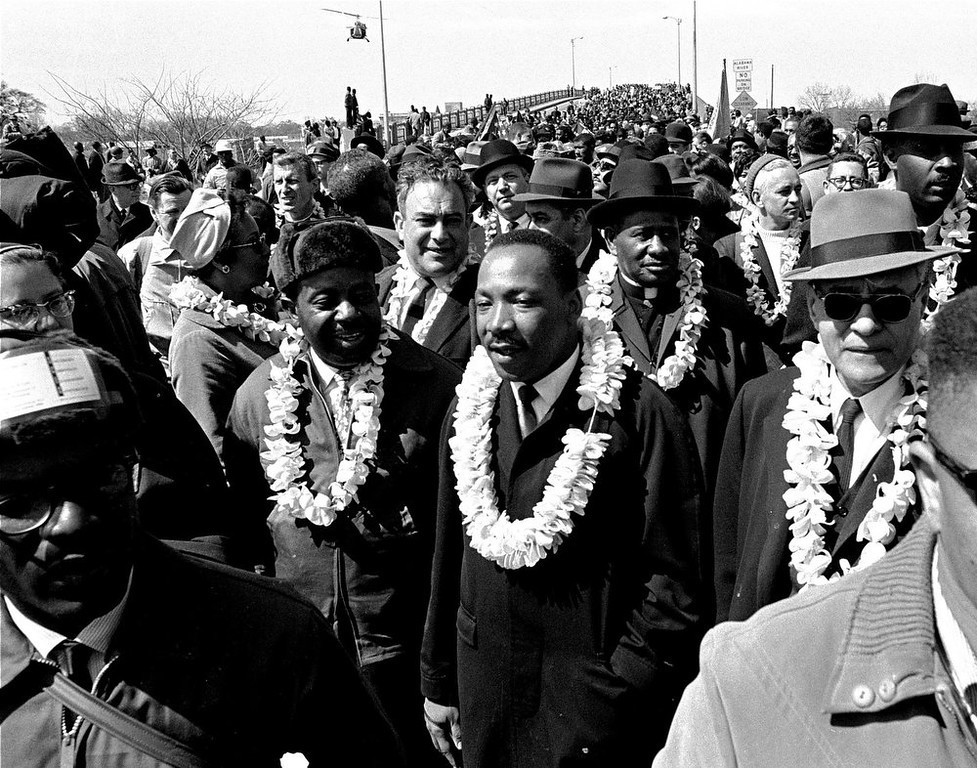 ". Martin Luther King, Jr. and his civil rights marchers cross the Edmund Pettus Bridge in Selma, Ala., heading for the capitol in Montgomery on March 21, 1965. Hundreds gathered Sunday, March 3, 2013 for a brunch with Vice President Joe Biden, and thousands were expected Sunday afternoon to march across this bridge in Selma\'s annual Bridge Crossing Jubilee. The event commemorates the ""Bloody Sunday\"" beating of voting rights marchers by state troopers as they began a march to Montgomery in March 1965. The 50-mile march prompted Congress to pass the Voting Rights Act that struck down impediments to voting by African-Americans and ended all-white rule in the South. (AP Photo/File) (AP Photo/File)"