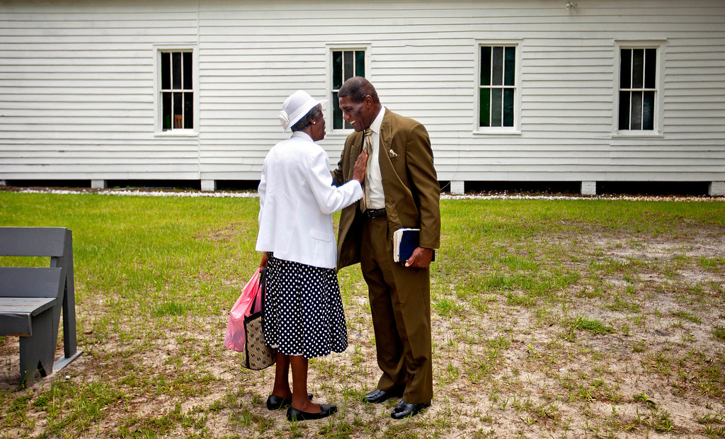. Annie Watts, 89, left, and Stephen Wilson, 68, talk after a church service for the 129th anniversary of St. Luke Baptist Church on Sapelo Island, Ga. on Sunday, June 9, 2013. Wilson is one of roughly 47 residents, most of them descendants of West African slaves known as Geechee, who remain on the coastal Georgia island where their ancestors were brought to work a plantation in the early 1800s. (AP Photo/David Goldman)
