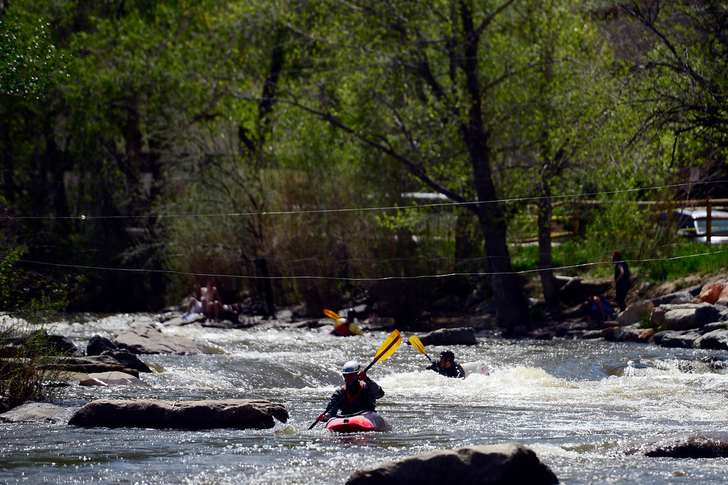 . Nick Casametta rides the water during Golden Games at the Clear Creek Whitewater Park. (Photo by AAron Ontiveroz/The Denver Post)