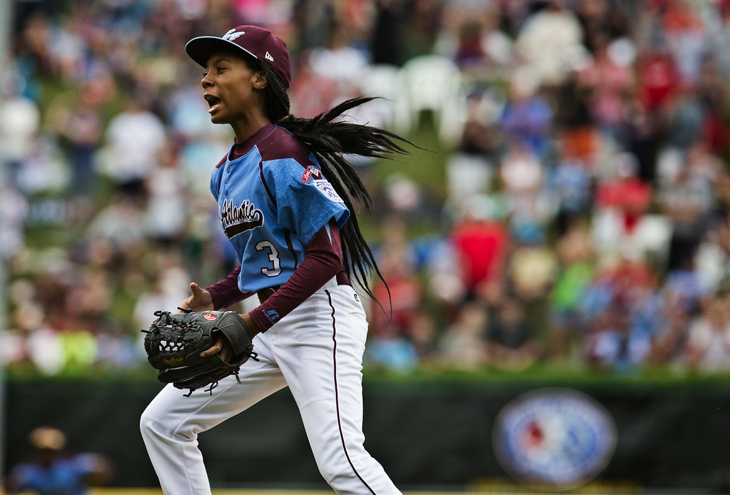 . Philadelphia\'s Mo\'ne Davis celebrates after the last pitch of her 4-0 win over Nashville in a U.S. pool play baseball game at the Little League World Series, Friday, Aug. 15, 2014, in South Williamsport, Pa. (AP Photo/PennLive.com, Sean Simmers)