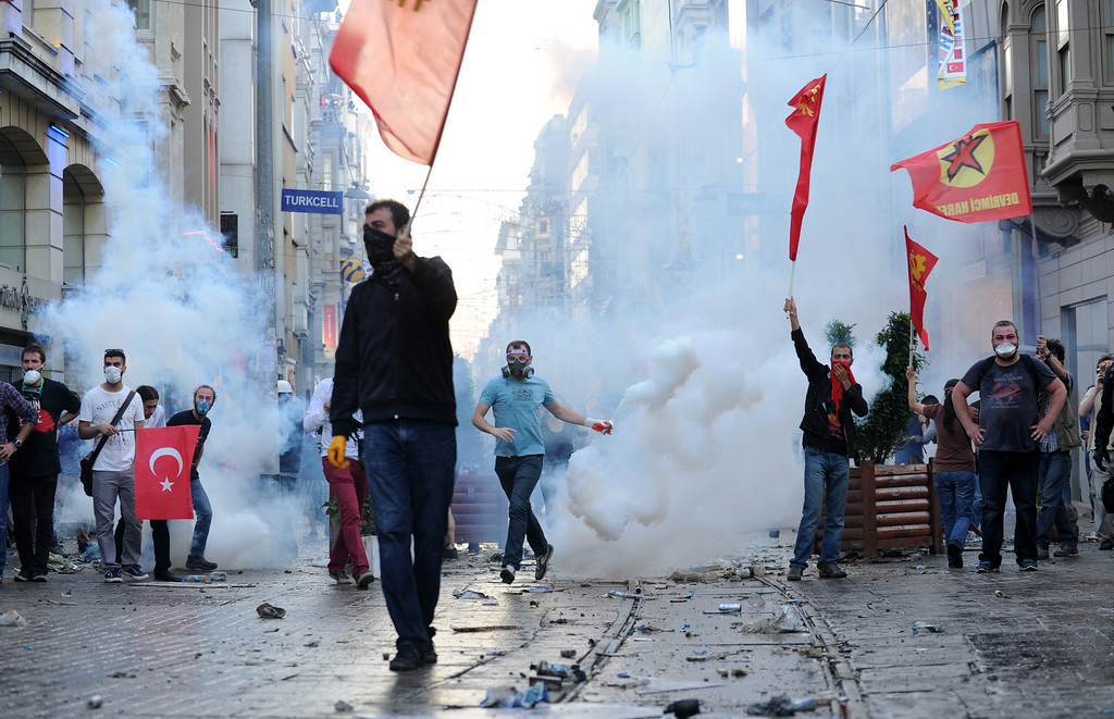 . Protestors clash with Turkish riot policemen during a protest against the demolition of Taksim Gezi Park on May 31, 2013, in Taksim quarter of Istanbul. Police reportedly used tear gas on early May 31 to disperse a group, who were standing guard in Gezi Parki to prevent the Istanbul metropolitan municipality from demolishing the last remaining green public space in the center of Istanbul as a part of a major  renewal project of Taksim. BULENT KILIC/AFP/Getty Images