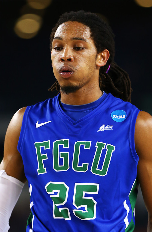 . ARLINGTON, TX - MARCH 29:  Sherwood Brown #25 of the Florida Gulf Coast Eagles reacts in the second half against the Florida Gators during the South Regional Semifinal round of the 2013 NCAA Men\'s Basketball Tournament at Dallas Cowboys Stadium on March 29, 2013 in Arlington, Texas.  (Photo by Tom Pennington/Getty Images)