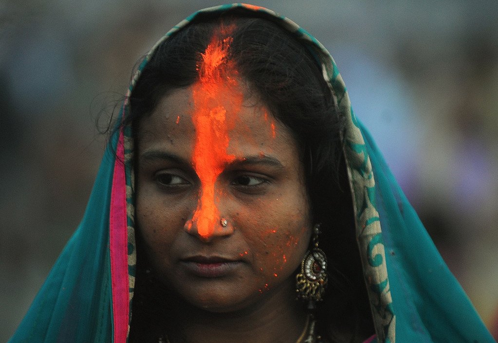 . An Indian woman offer prayers at the seafront during the \'Chhath Puja\' festival in Mumbai on November 8, 2013.    AFP PHOTO/ PUNIT  PARANJPE/AFP/Getty Images