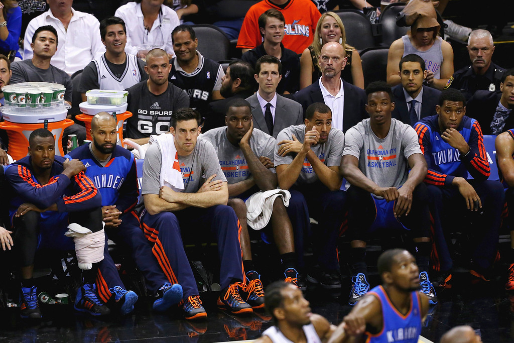 . The Oklahoma City Thunder bench looks on in the second half against the San Antonio Spurs during Game Five of the Western Conference Finals of the 2014 NBA Playoffs at AT&T Center on May 29, 2014 in San Antonio, Texas.   (Photo by Chris Covatta/Getty Images)