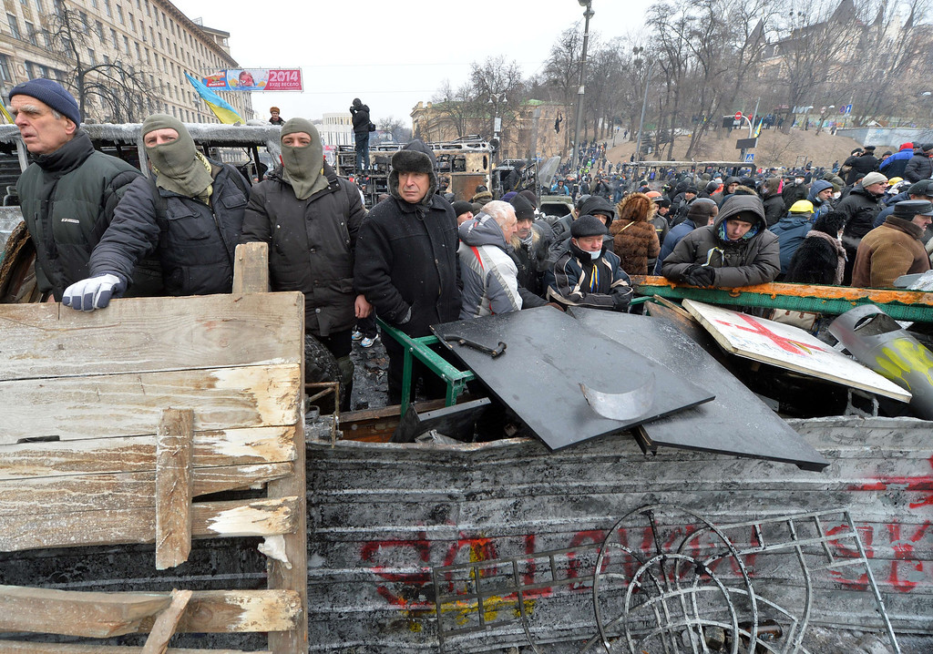 . People stand on a barricade during clashing break of the opposition and the police in Kiev on January 21, 2014. Russia on Tuesday warned the situation in Ukraine was spiraling out of control after a second night of violent clashes between pro-EU protesters and security forces in the centre of Kiev.  AFP PHOTO / SERGEI  SUPINSKY/AFP/Getty Images