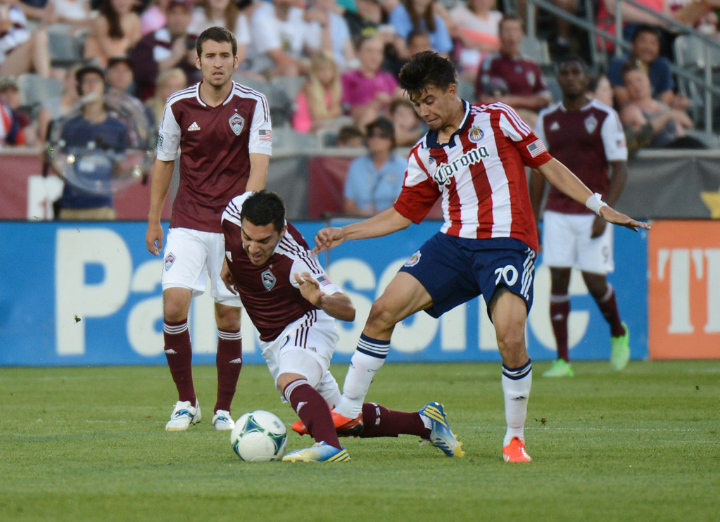 . COMMERCE CITY, CO. - MAY 25: Martin Rivero of Colorado Rapids (10) fouled by Carlos Alvarez of Chivas USA (20) in the 1st half of the game at Dick\'s Sporting Goods Park. Commerce City, Colorado. May 25, 2013. (Photo By Hyoung Chang/The Denver Post)