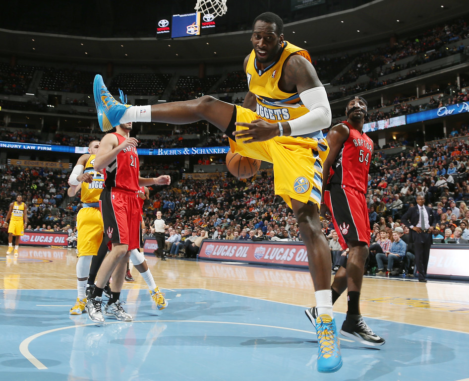 . Denver Nuggets forward J.J. Hickson, foreground, reacts after being fouled while going up to shoot as Toronto Raptors forward Patrick Patterson looks on in the fourth quarter of an NBA basketball game in Denver, Friday, Jan. 31, 2014. (AP Photo/David Zalubowski)