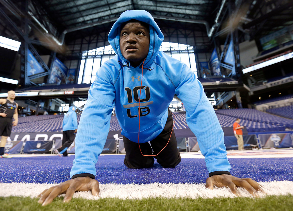. Iowa State linebacker Jeremiah George stretches on the field at the NFL football scouting combine in Indianapolis, Monday, Feb. 24, 2014. (AP Photo/Nam Y. Huh)