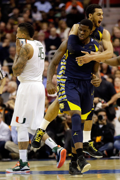 . WASHINGTON, DC - MARCH 28:  Jamil Wilson #0 and Trent Lockett #22 of the Marquette Golden Eagles react after a play against the Miami (Fl) Hurricanes during the East Regional Round of the 2013 NCAA Men\'s Basketball Tournament at Verizon Center on March 28, 2013 in Washington, DC.  (Photo by Win McNamee/Getty Images)