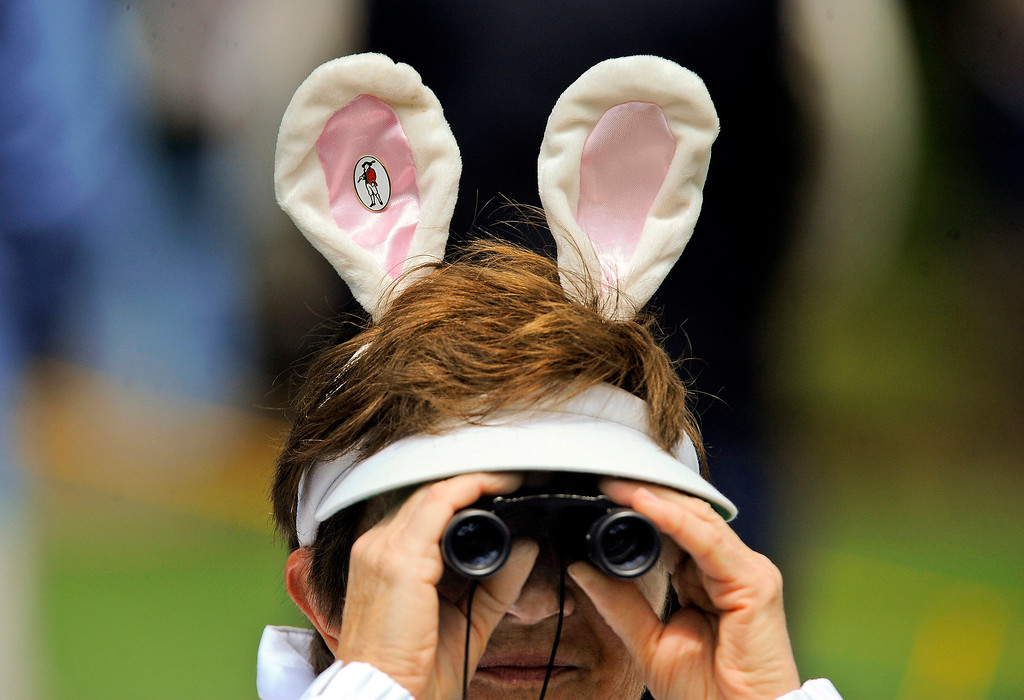. Carol Fabish watches the action on the sixth green while wearing bunny ears for Easter during the final round of the RBC Heritage golf tournament in Hilton Head Island, S.C., Sunday, April 20, 2014. (AP Photo/Stephen B. Morton)