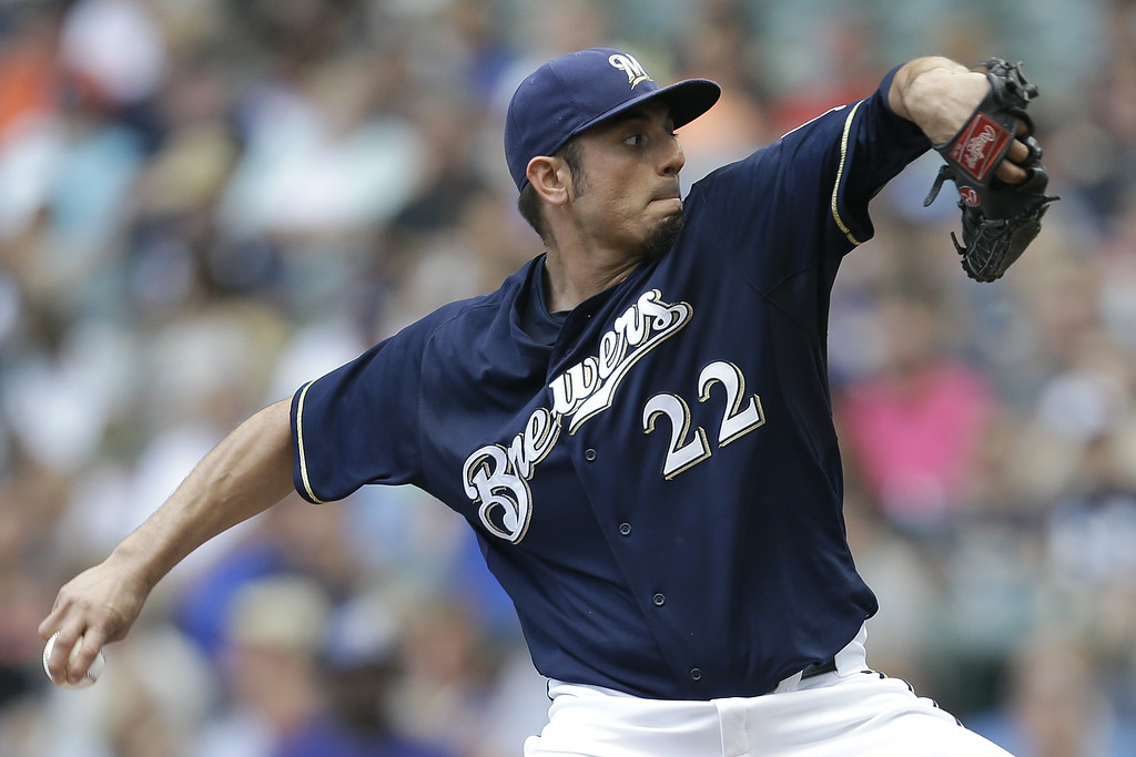 . MILWAUKEE, WI - JUNE 28: Matt Garza #22 of the Milwaukee Brewers pitches during the first inning against the Colorado Rockies at Miller Park on June 28, 2014 in Milwaukee, Wisconsin. (Photo by Mike McGinnis/Getty Images)