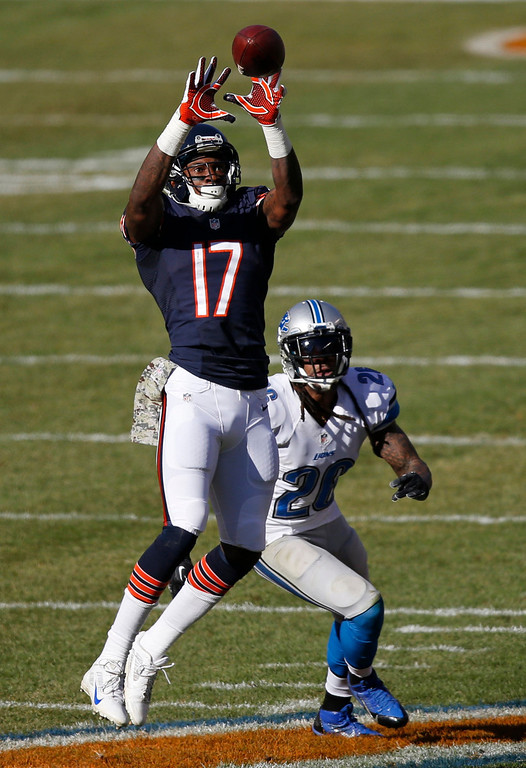 . Chicago Bears wide receiver Alshon Jeffery (17) makes a catch in front of Detroit Lions safety Louis Delmas (26) during the first half of an NFL football game, Sunday, Nov. 10, 2013, in Chicago. (AP Photo/Charles Rex Arbogast)