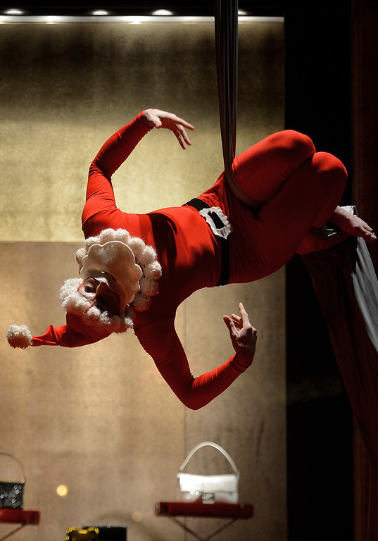 . A performer dressed as Santa Claus performs a show during a Christmas sunday shopping in central Rome on December 16, 2012.   FILIPPO MONTEFORTE/AFP/Getty Images