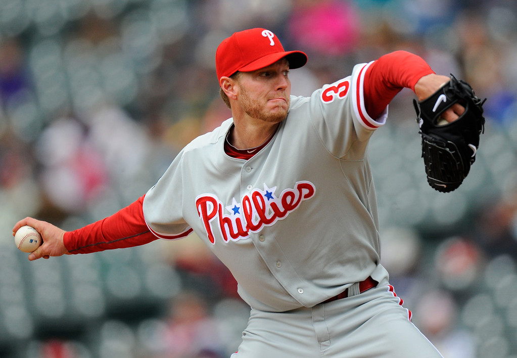 . Philadelphia Phillies starting pitcher Roy Halladay (34) delivers a pitch against the Colorado Rockies Wednesday, May 12, 2010 at Coors Field. . John Leyba, The Denver Post