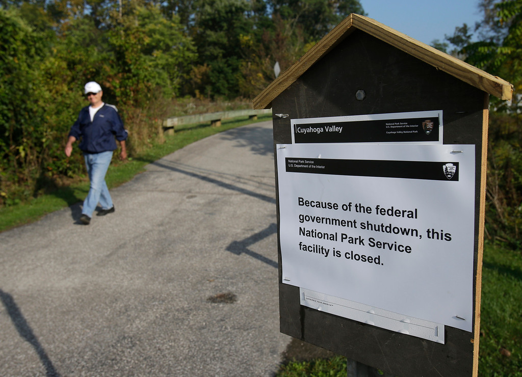 . John Carano, 65, walks on a trail at the Cuyahoga Valley National Park Tuesday, Oct. 1, 2013, in Valley View, Ohio. The impacts of the federal shutdown began rippling across Ohio on Tuesday morning, with a national military museum and national park closing and thousands of federal employees going on furlough. (AP Photo/Tony Dejak)