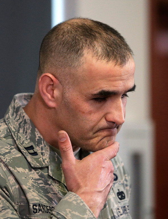 . Washington Air National Guard Capt. Brad Sanders listens to a question at a news conference about working at the scene of a deadly mudslide Thursday, March 27, 2014, in Arlington, Wash. (AP Photo/Elaine Thompson)