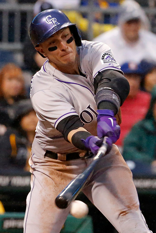 . Colorado Rockies shortstop Troy Tulowitzki (2) grounds out to end the fourth inning of a baseball game against the Pittsburgh Pirates in Pittsburgh Saturday, July 19, 2014. Tulowitzki grimaced as he walked back to the dugout and did not remain in the game.(AP Photo/Gene J. Puskar)