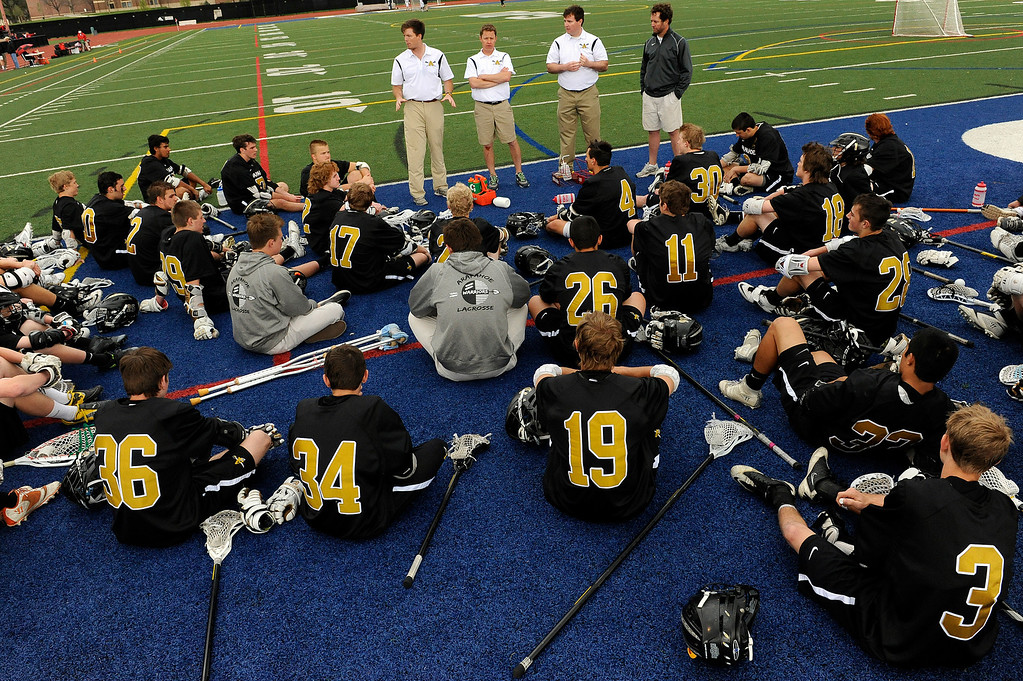 . DENVER, CO - MAY 15: Arapahoe High School lacrosse player get a pep talk from coaches at halftime against Regis Jesuit during the semifinals of the CHSAA 5A boys lacrosse at All City Stadium on May 15, 2013, in Denver, Colorado. Arapahoe won 13-5 to advance to the finals. (Photo by Daniel Petty/The Denver Post)