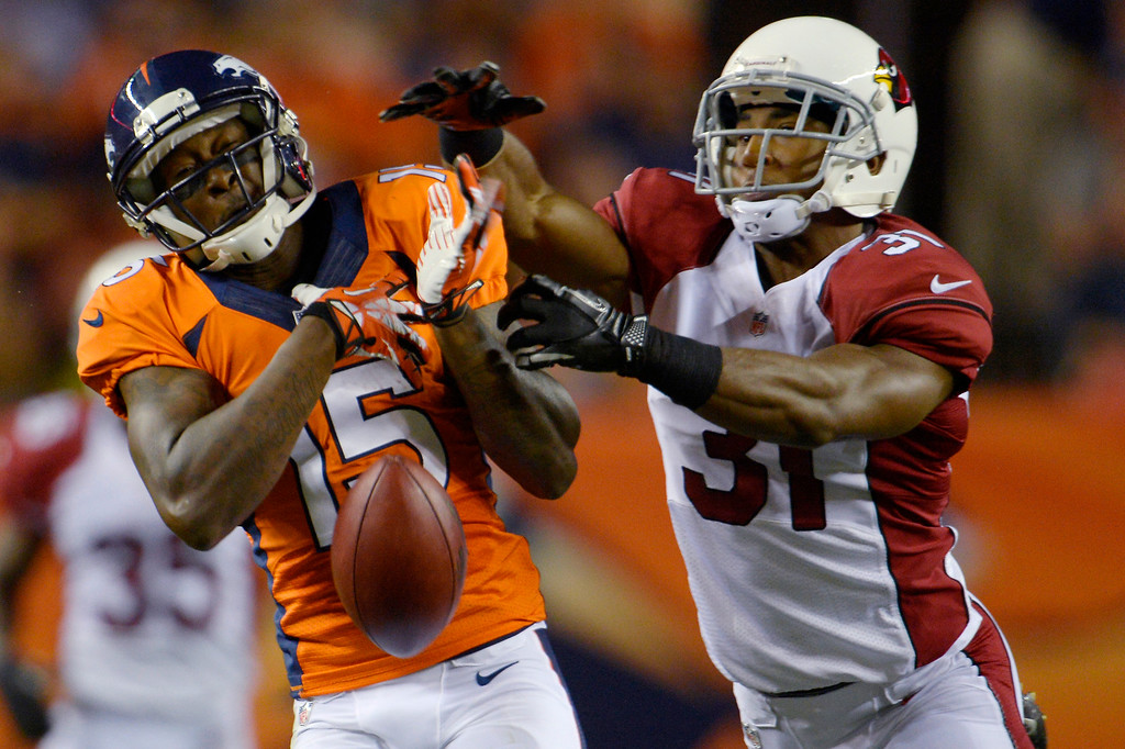. Tavarres King (15) of the Denver Broncos drops a pass as Justin Bethel (31) of the Arizona Cardinals defends during the last pre-season game of the season at Sports Authority Field at Mile High. August 29, 2013 Denver, Colorado. (Photo By Joe Amon/The Denver Post)