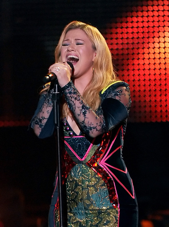 ". LOS ANGELES, CA - DECEMBER 16:  Singer Kelly Clarkson performs onstage during ""VH1 Divas\"" 2012 at The Shrine Auditorium on December 16, 2012 in Los Angeles, California.  (Photo by Kevin Winter/Getty Images)"