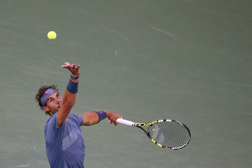 . Rafael Nadal of Spain serves during his men\'s singles final match against Novak Djokovic on Day 15 of the 2013 US Open at USTA Billie Jean King National Tennis Center on September 9, 2013 in the Flushing neighborhood of the Queens borough of New York City.  (Photo by Joe Scarnici/Getty Images)
