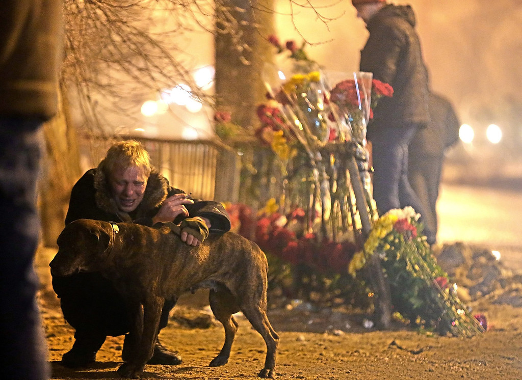 . A Russian man mourns at the site of the second terrorist explosion happened on a trolleybus, at a street in Volgograd, Russia on Monday, Dec. 30. According to media reports, at least 31 people were killed and many were injured in two suicide bombing attack in the city during the last two days.  EPA/MAXIM SHIPENKOV
