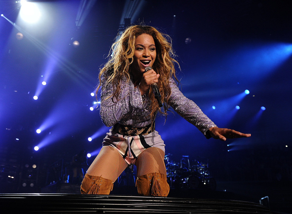 """. Singer Beyonce performs on her \""""Mrs. Carter Show World Tour 2013\"""", on Wednesday, April 17, 2013 at the Arena Zagreb in Zagreb, Croatia. Beyonce is wearing a lilac jacket and boots by Pucci. (Photo by Frank Micelotta/Invision for Parkwood Entertainment/AP Images."""