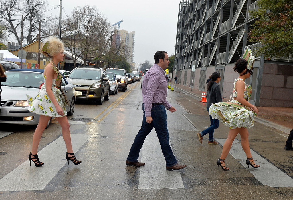 ". Jared ""the SUBWAY Guy\"" and SUBWAY models stop traffic on their way to the Austin Convention Center from SXSUBWAY Square at SXSW in Austin, Texas on Saturday, March 8, 2014.  (Photo by Jack Dempsey/Invision for SUBWAY Restaurants/AP Images)"