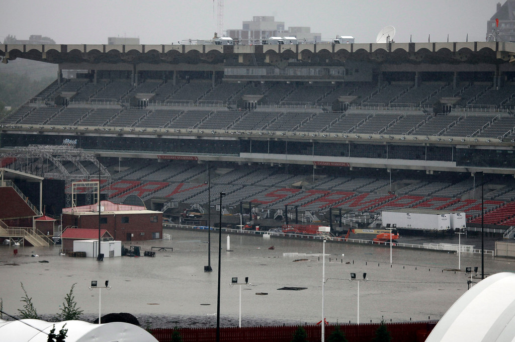 . The Calgary Stampede rodeo grounds are flooded due to the heavy rains have caused flooding, closed roads, and forced evacuation in Calgary, Alberta, Canada, on Friday June 21, 2013.   (AP Photo/The Canadian Press, Jeff McIntosh)