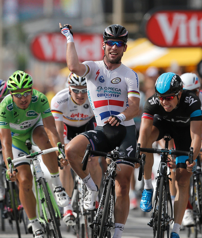 . Britain\'s Marc Cavendish crosses the finish line ahead of Edvald Boasson Hagen of Norway, second place, right, Peter Sagan of Slovakia, third place, left, and Andre Greipel of Germany, second left and fourth place, to win the fifth stage of the Tour de France cycling race over 228.5 kilometers (142.8 miles) with start in Cagnes-sur-Mer and finish in Marseille, southern France, Wednesday July 3, 2013.  (AP Photo/Christophe Ena)