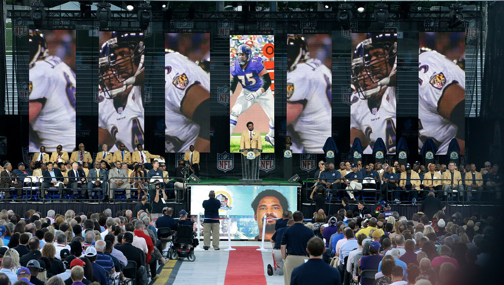 . Former NFL football player Jonathan Ogden speaks during the induction ceremony at the Pro Football Hall of Fame Saturday, Aug. 3, 2013, in Canton, Ohio. (AP Photo/Tony Dejak)