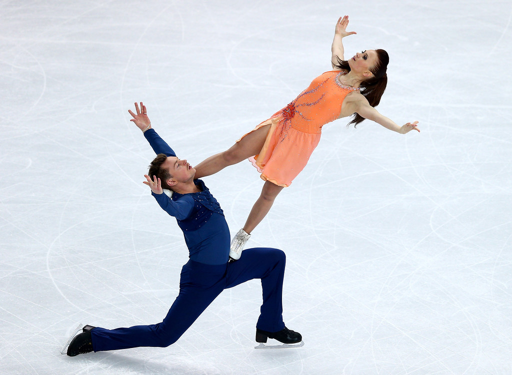 . Julia Zlobina and Alexei Sitnikov of Azerbaijan compete in the Figure Skating Ice Dance Free Dance on Day 10 of the Sochi 2014 Winter Olympics at Iceberg Skating Palace on February 17, 2014 in Sochi, Russia.  (Photo by Clive Mason/Getty Images)